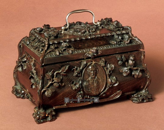 This tea caddy, wrongly attributed to Thomas Sharp, bears Shakespeare's bust and coat of arms.