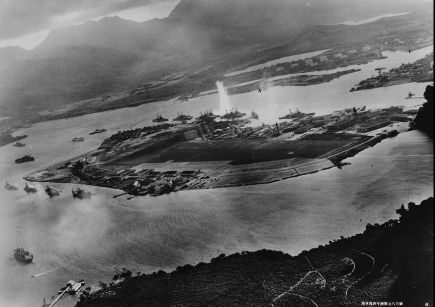 A picture taken from a Japanese fighter jet (where did they find the time?!) as one of the first torpedoes hit the USS West Virginia at Pearl Harbor.